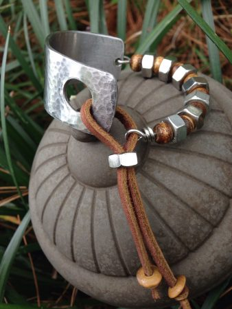 Stainless Steel, Bone and Leather Bracelet by Juan Valerio  - featured on Jewelry Making Journal