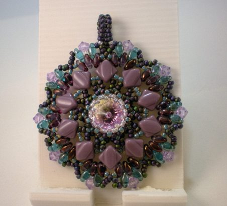 Woven pendant by Lisa Lavado  - featured on Jewelry Making Journal