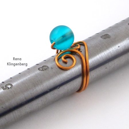 Shaping the ring around the mandrel - Bead and Scroll Adjustable Wire Ring - Tutorial by Rena Klingenberg