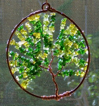 "<img src=""https://jewelrymakingjournal.com/wp-content/uploads/2017/01/DSCN6128-452x437.jpg"" alt=""Spring and Summer Tree Sun Catchers by Nancy Vaughan"" width=""452"" height=""437"" class=""size-large wp-image-47950"" /> A Spring Cherry Tree"