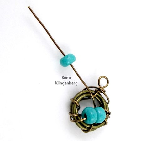 Easy Bird's Nest Wire Earrings - Tutorial by Rena Klingenberg - attaching bead eggs to nest