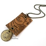 Leather Pendant with Grommets (Tutorial)