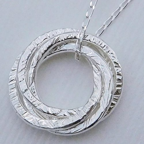 Entwined Rings Pendant by Jacqueline Grant - featured on Jewelry Making Journal